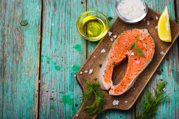 fresh raw salmon steak with herbs and spices