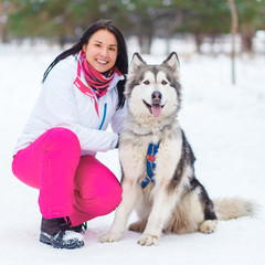 girl with malamute winter