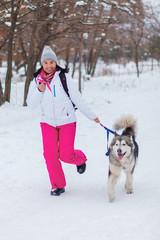 girl with malamute winter