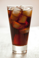 Glass of cold cola soda refreshment drink with bubbles
