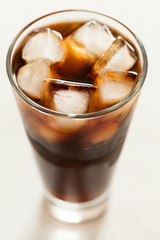 Cola cold sweet soda beverage  with ice and bubbles in glass