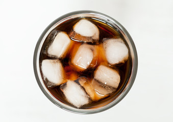 Glass of refreshing cold cola sweet soda drink