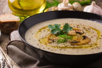 Mushroom cream soup on rustic background