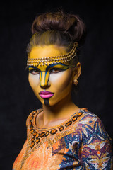 Beautiful woman with tribal face make up