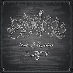 Vegetables and fruits on chalkboard styled background
