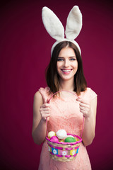Smiling beautiful woman with an Easter egg basket