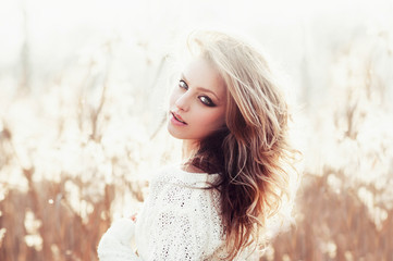 Sunny portrait of a beautiful young blonde girl