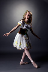 Thoughtful young ballerina dancing in folk dress