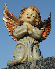 angelic sweet figurine with colorful wings isolated on sky