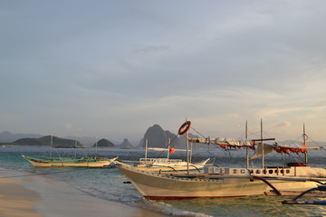 The sea cliffs on the horizon and the boats
