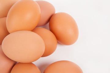Chicken eggs  on white paper background