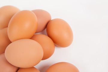 Chicken eggs  on white paper background
