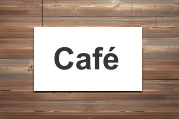 canvas hanging on wooden wall cafe