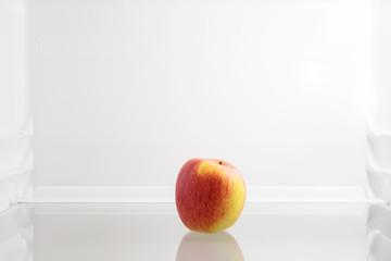 Fresh apple in fridge