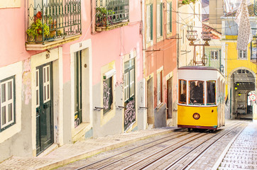 Traditional yellow trams on a street in Lisbon, Portugal Fototapete