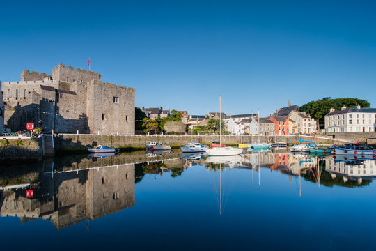 Castle Rushen in Castletown in the Isle of Man, with reflections in the harbour