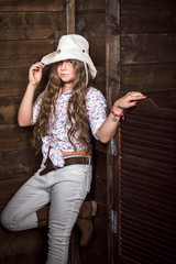 Cute teenager girl in a cowboy hat