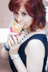 Young pretty girl eating ice cream