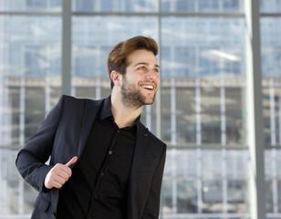 Happy man in black business suit