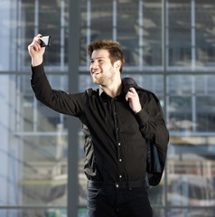 Attractive young modern man taking selfie