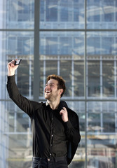Happy young man taking selfie in the city
