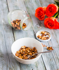 homemade granola with nuts and dried fruits, flowers