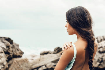 beautiful girl on the beach alone