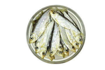 salted sprats in a glass cup on a white background