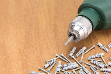 Drill and screws on wooden table