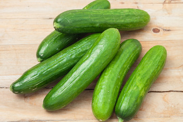 a pile of fresh picked cucumbers
