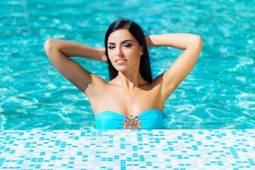 Beautiful woman in outdoor pool. Spa portrait.