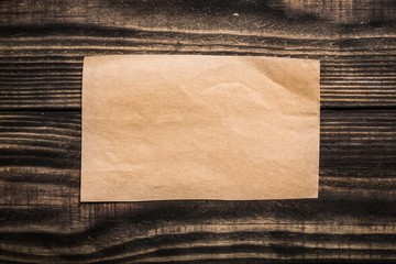 Paper. Old blank parchment on aged wood background,horizontal