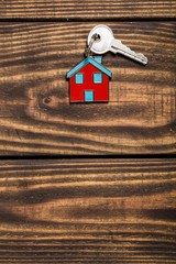 Key. Symbol of the house with silver key on vintage wooden