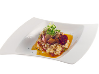 fried rabbit with spicy red sauce, risotto & chorizo