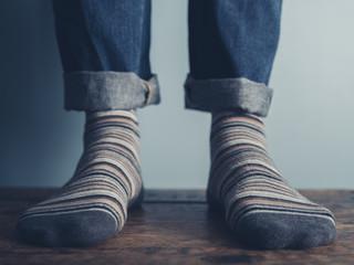 Feet of a man on wooden floor
