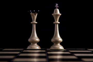Chess figures on a black background