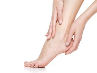 Beautiful women feet isolated on white. Close-up.