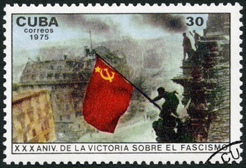 CUBA - 1975: shows Raising red flag over Reichstag, Berlin