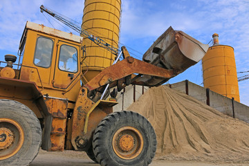 Loader works with gravel and sand, construction materials