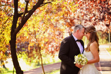 Bride and groom on a autumn day
