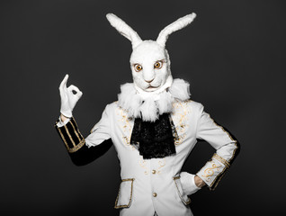 Bunny standing in white suit  having made  helpless gesture