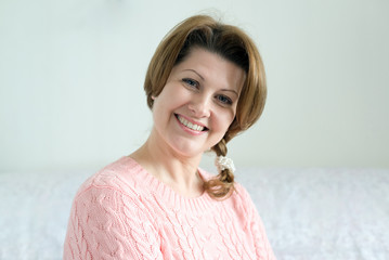 Portrait of positive woman in pink sweater
