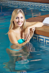 Woman in water in swimming pool