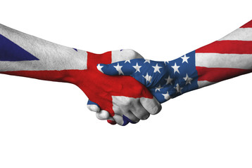 United Kingdom flag and USA flag across handshake.