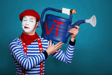 mime with  toy video camera in hands