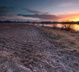 Lake near field after sunset