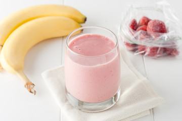 homemade banana and frozen strawberry smoothie