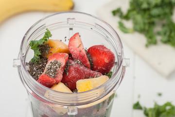 homemade breakfast smoothie ingredients in a blender cup