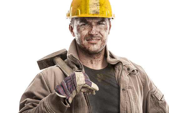 Young dirty Worker Man With Hard Hat helmet  .holding a hammer a