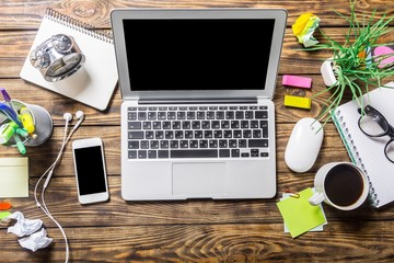 View. Mix of office supplies and gadgets on a wooden desk